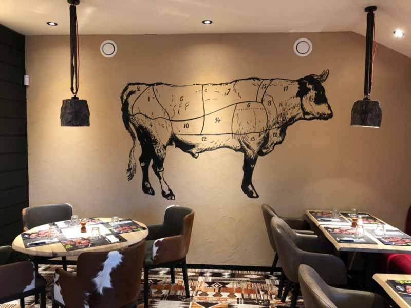 Fresque restaurant hippopotamus peinte à la main
